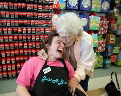 Developmentally Disabled Individual working at retail store.